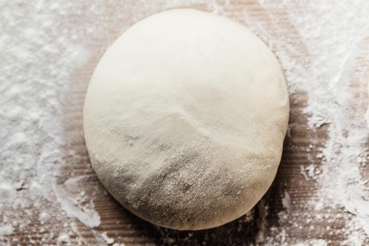 Pizza dough / Manuel Sulzer / Getty Images