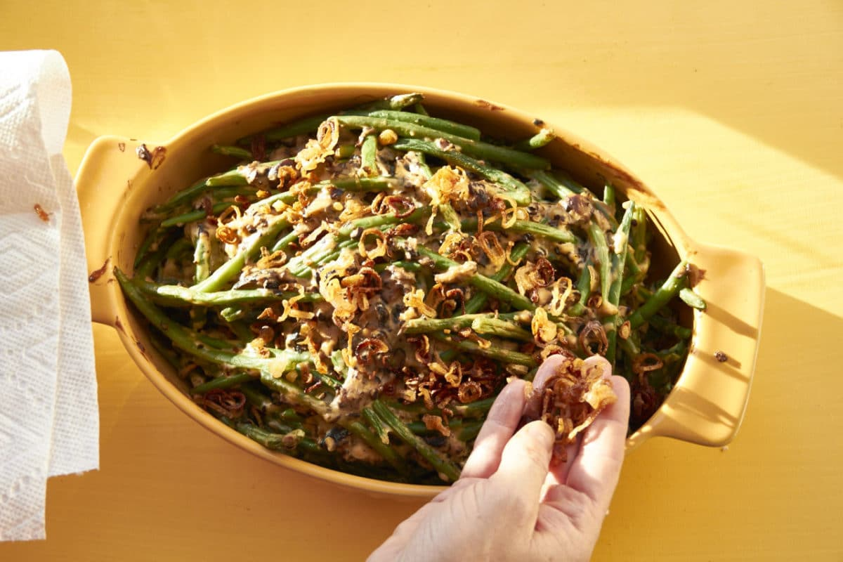 Sprinkling over the fried shallots / Katie Workman / themom100.com / Photo by Laura Agra