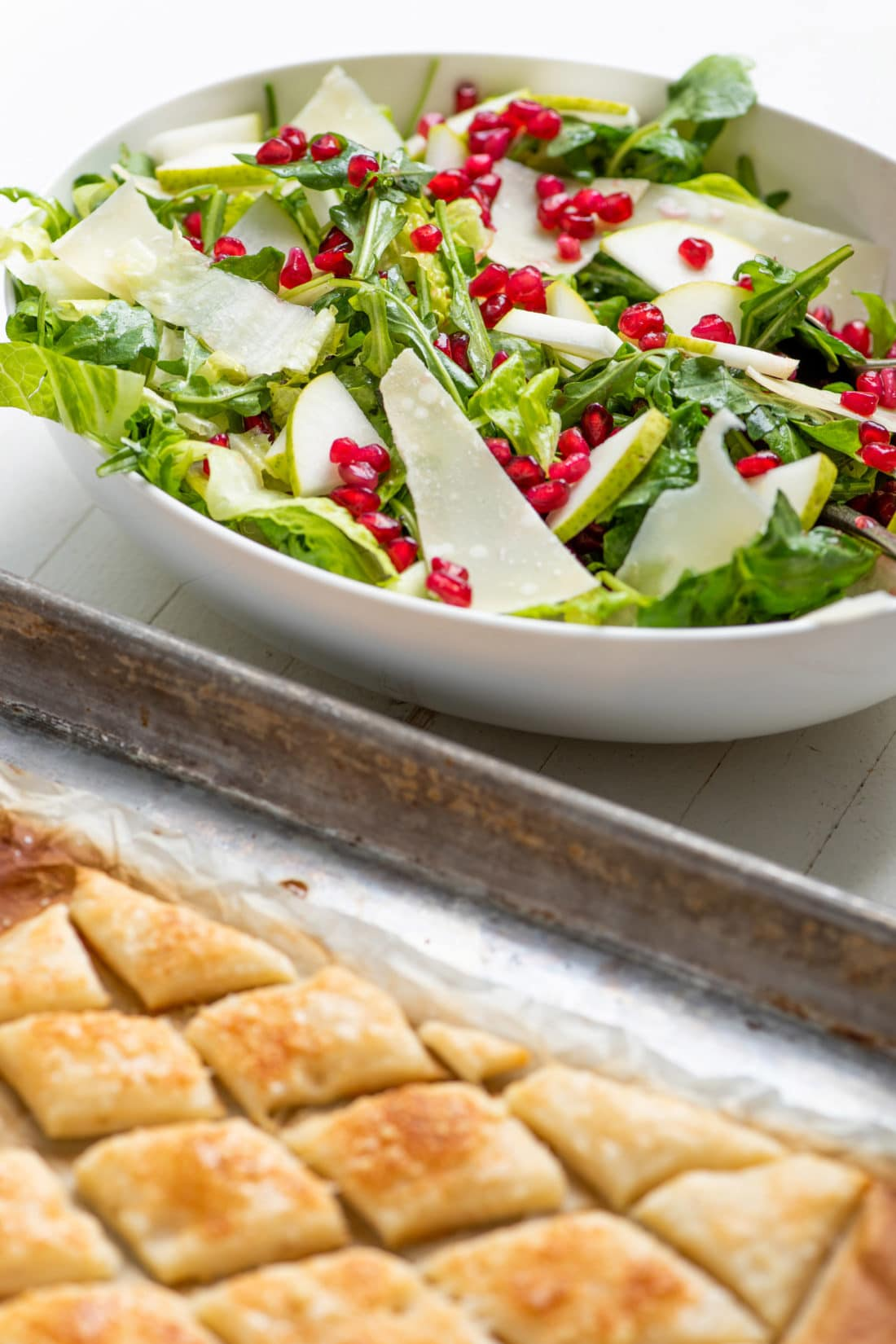 Green Salad with Pears, Parmesan and Pomegranate Seeds / Katie Workman / themom100.com / Photo by Cheyenne Cohen
