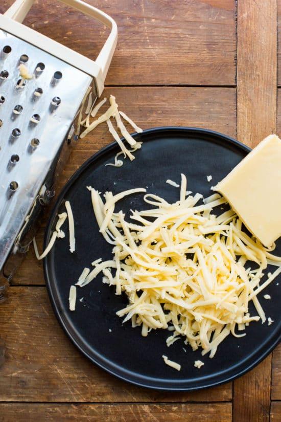 Grating Cheese / Katie Workman / themom100.com / Photo by Mia